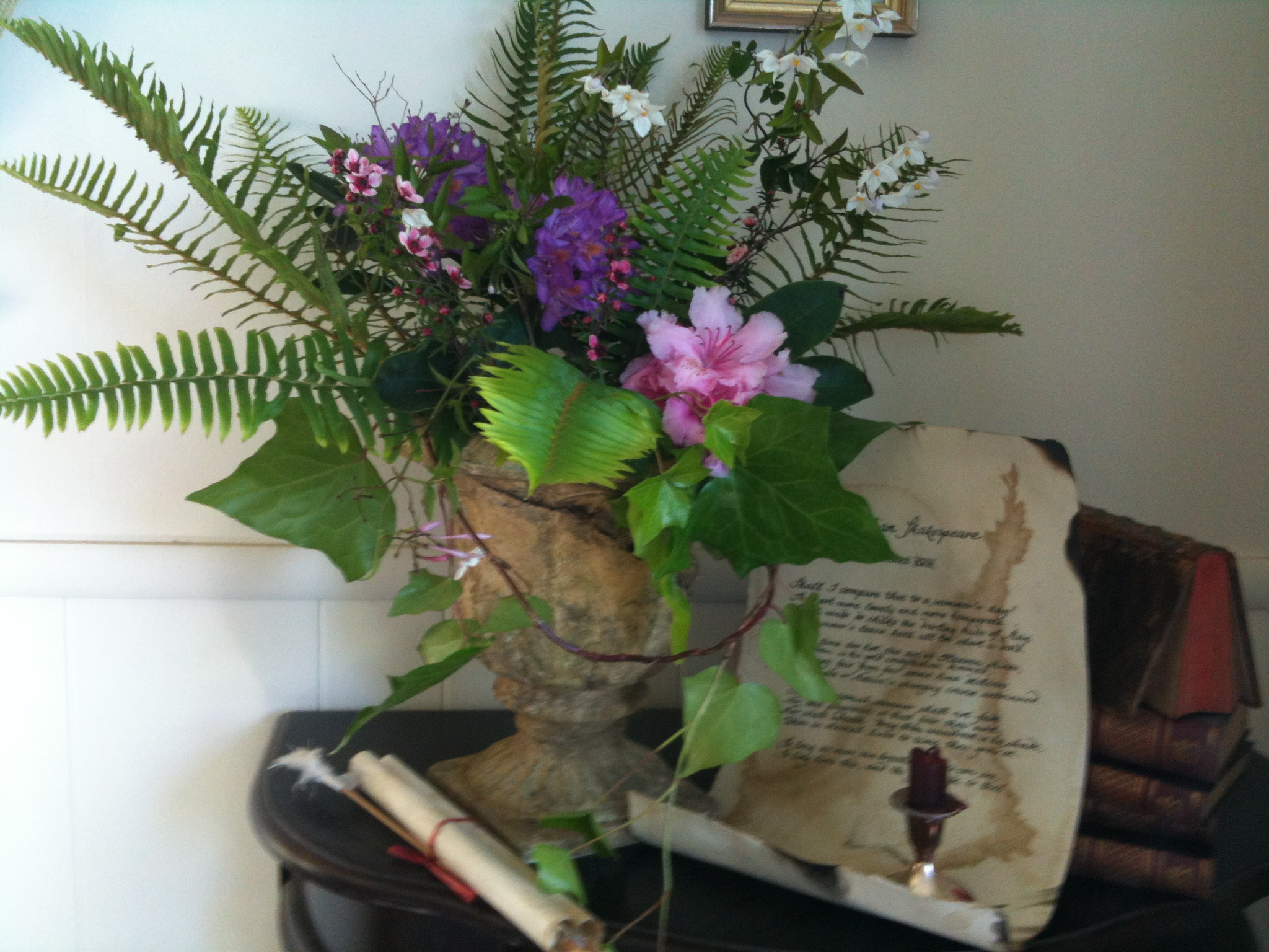 Romantic flower arrangements around antique books